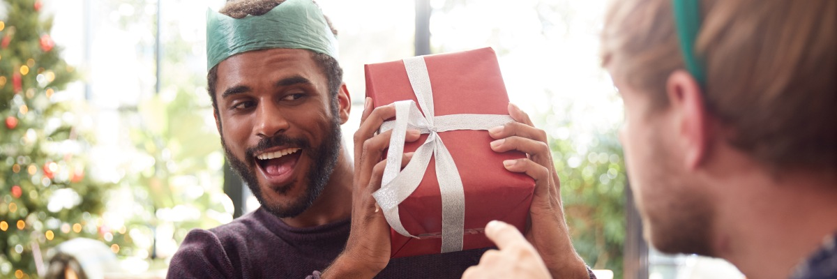 men exchanging christmas gifts