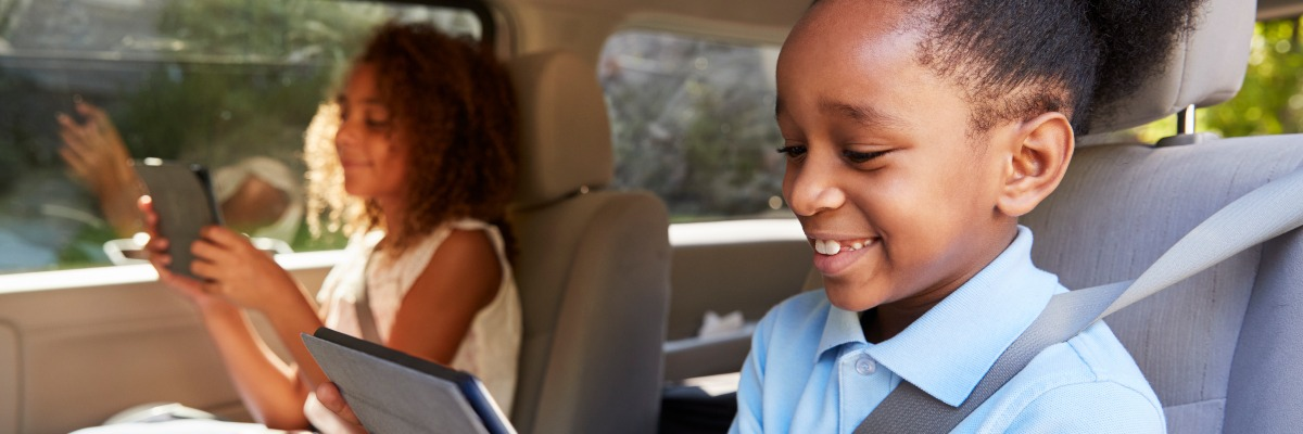 Children in the car on game devices