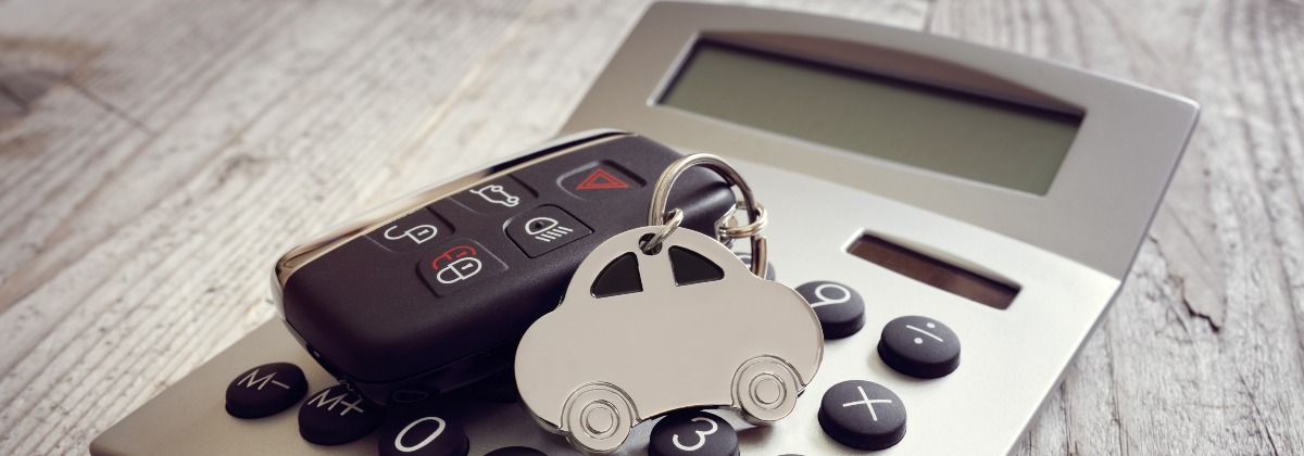 The new budget - image shows calculator with a a car key and keyring on it