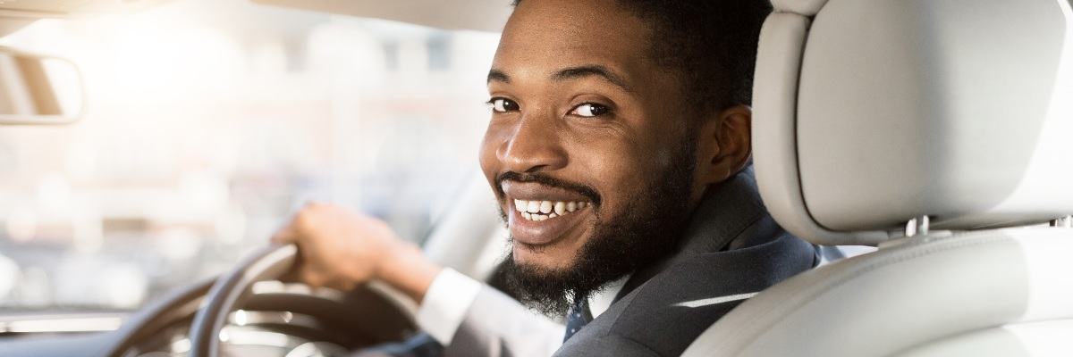 man happy to be on driving lessons