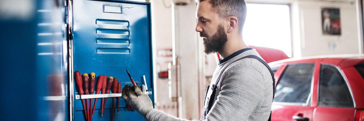 car mechanic selecting tools for MOT