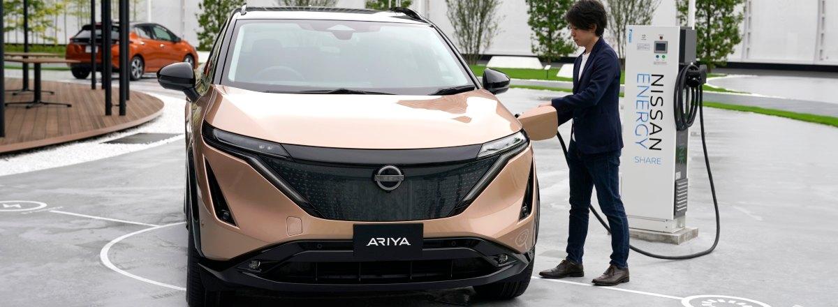man charging his Nissan