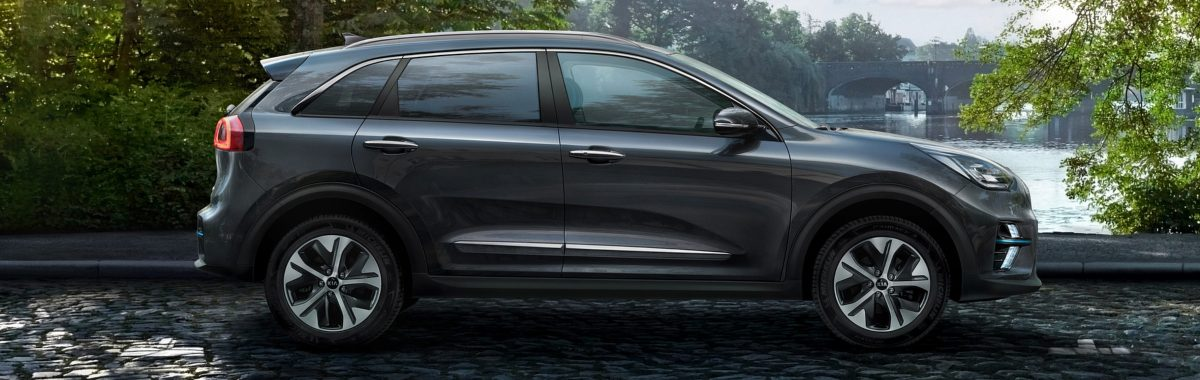 best car for a staycation - side view of Kia e-Niro