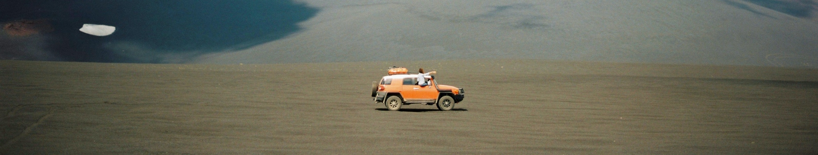 Orange SUV in the desert