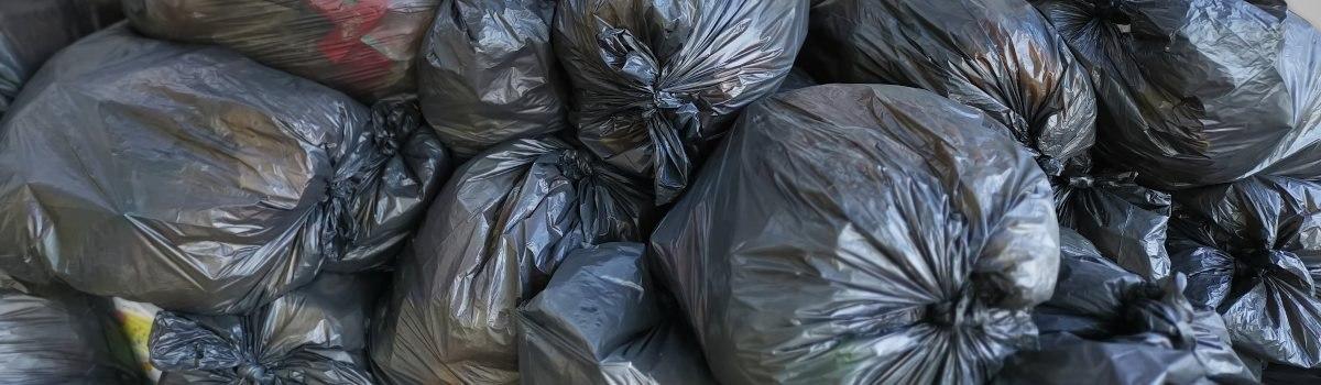 roadside litter in bin bags
