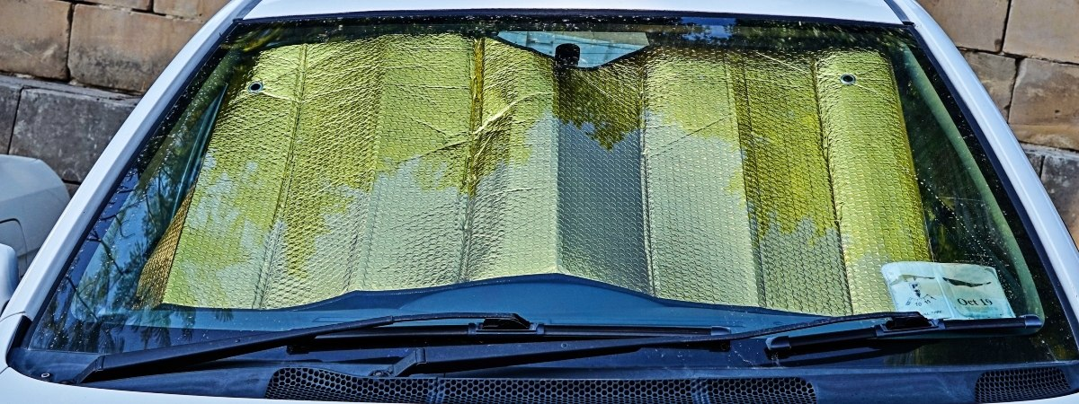 Use of a windscreen to block the sun from the car.